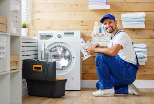 Engineer repairing a washing machine in Manchester