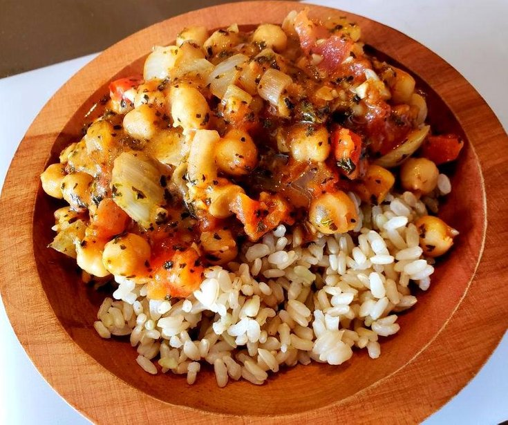 Bowl of chickpea curry over brown rice