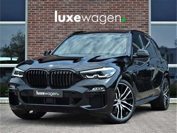 "BMW X5 M50d 400pk Skylounge Luchtv DA+ PA+ Trekh NL-auto 22"" Comfortzetels"