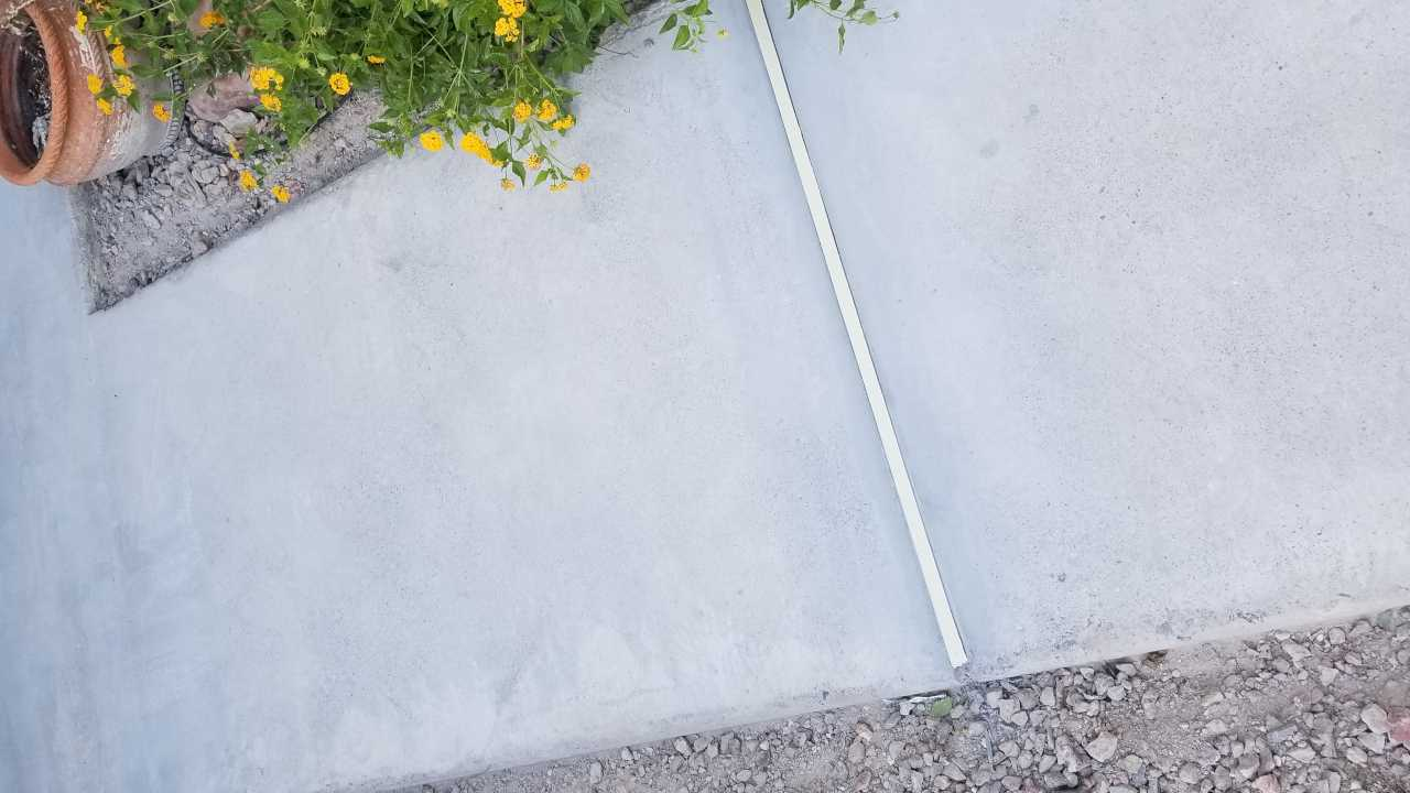 Closeup shot of walkway concrete with custom concrete separation joints during resotoration
