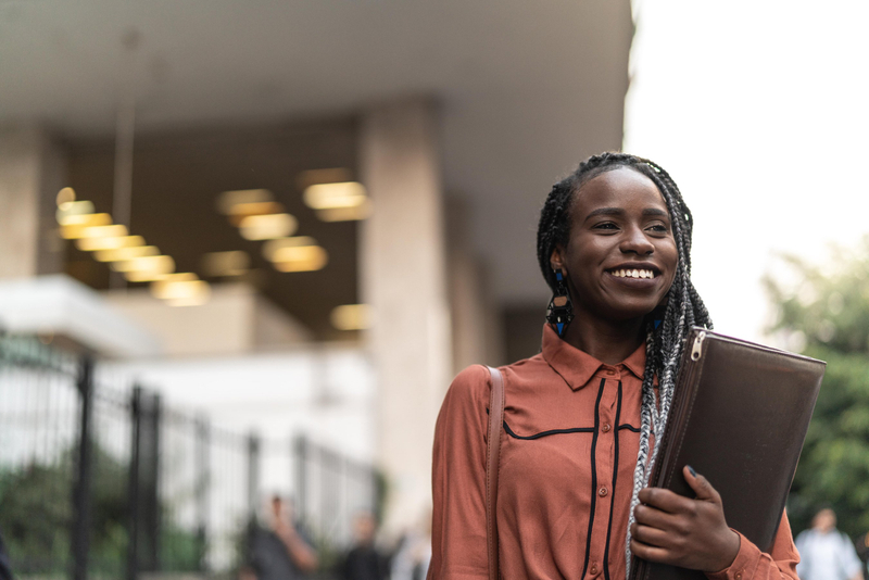 Female student holding a leather case at the University of London