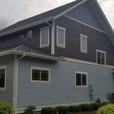 side view of a light blue painted hme exterior with a purple accent color
