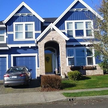 blue house with white trim