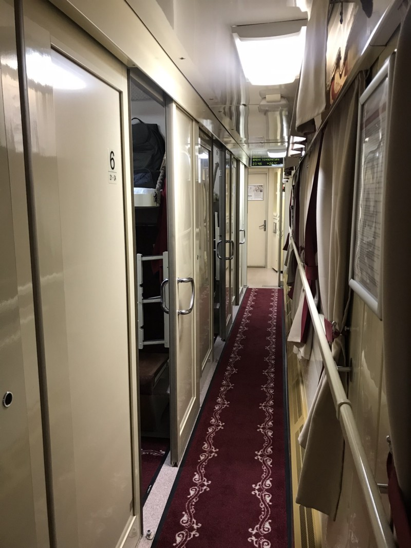 Carpeted hallway of the second-class car.