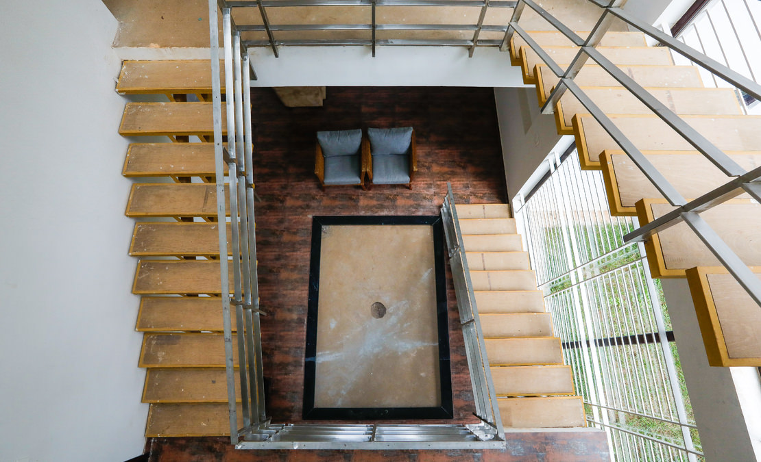 Winding staircase leading up to the balcony