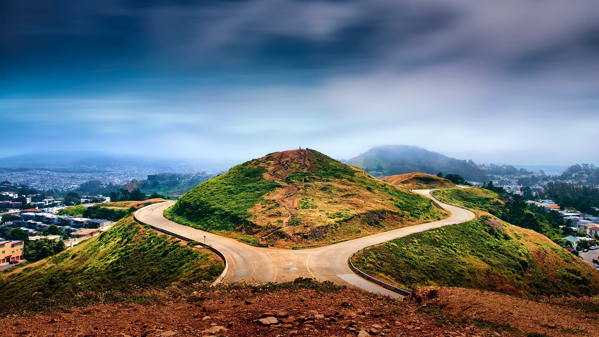 Two roads around a hill