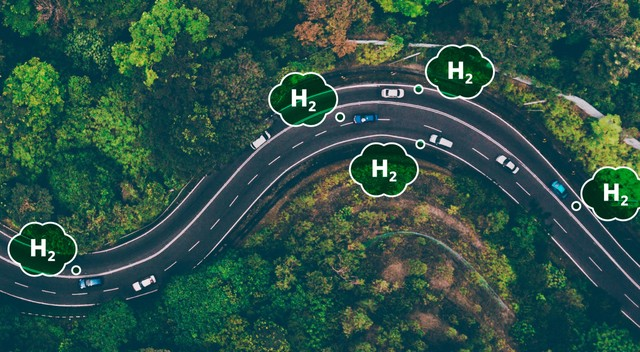 Photo illustration of an aerial view of cars that are powered by green hydrogen on a highway.