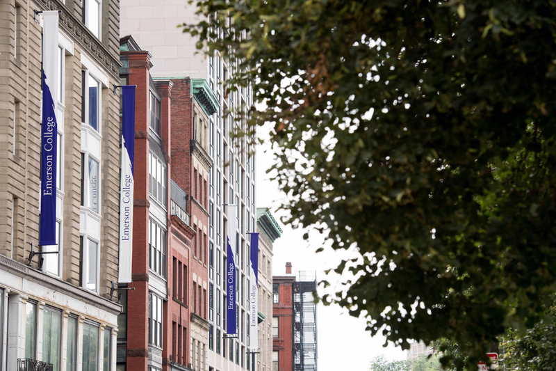School banners hung vertically along the sides of academic buildings at Emerson College