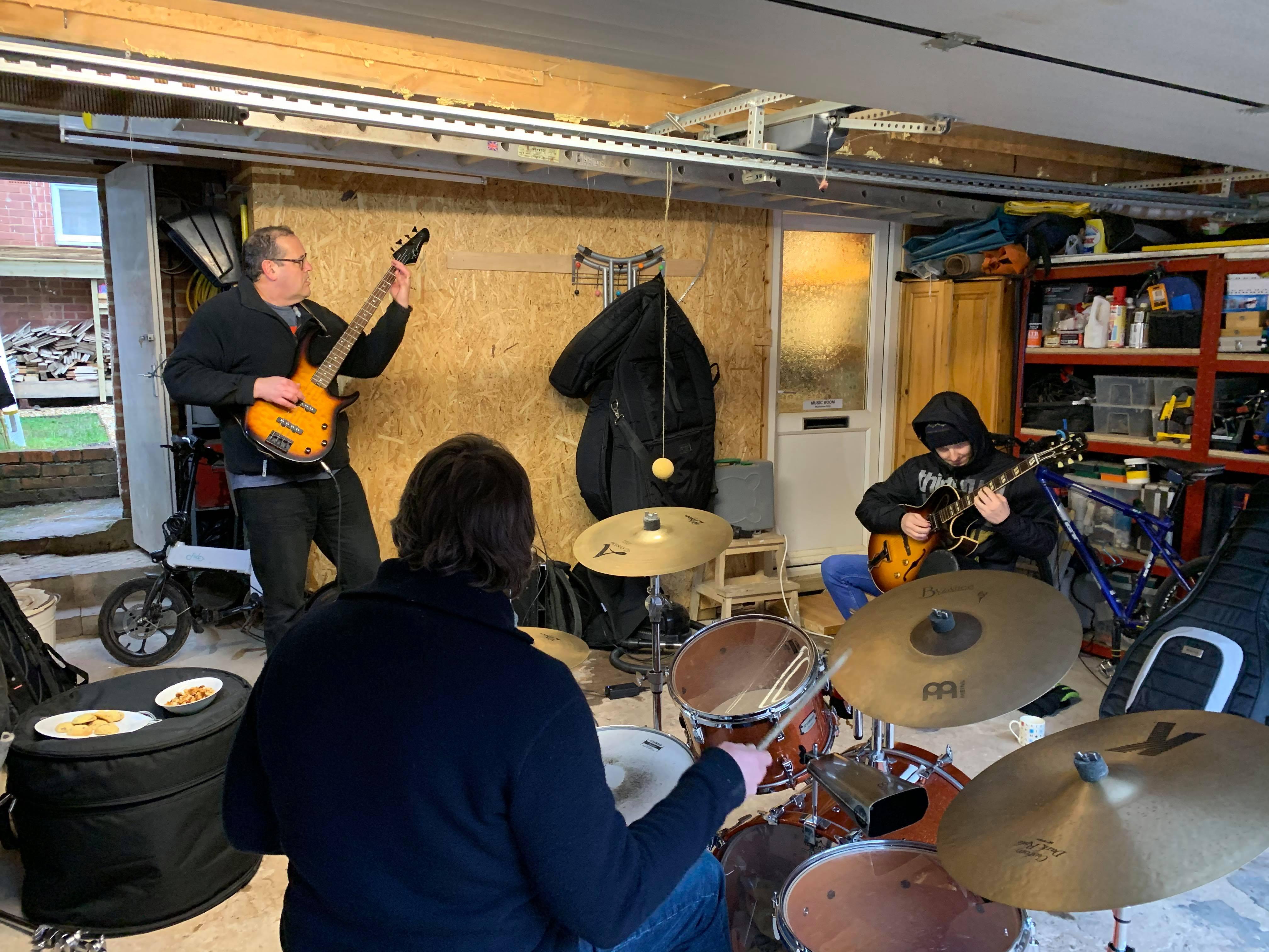 Drum, bass, guitar jamming