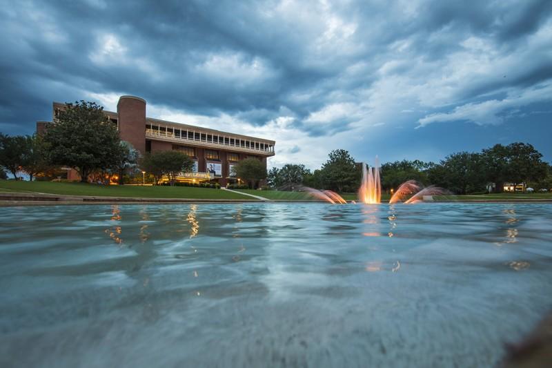 The UCF Library and lake at night
