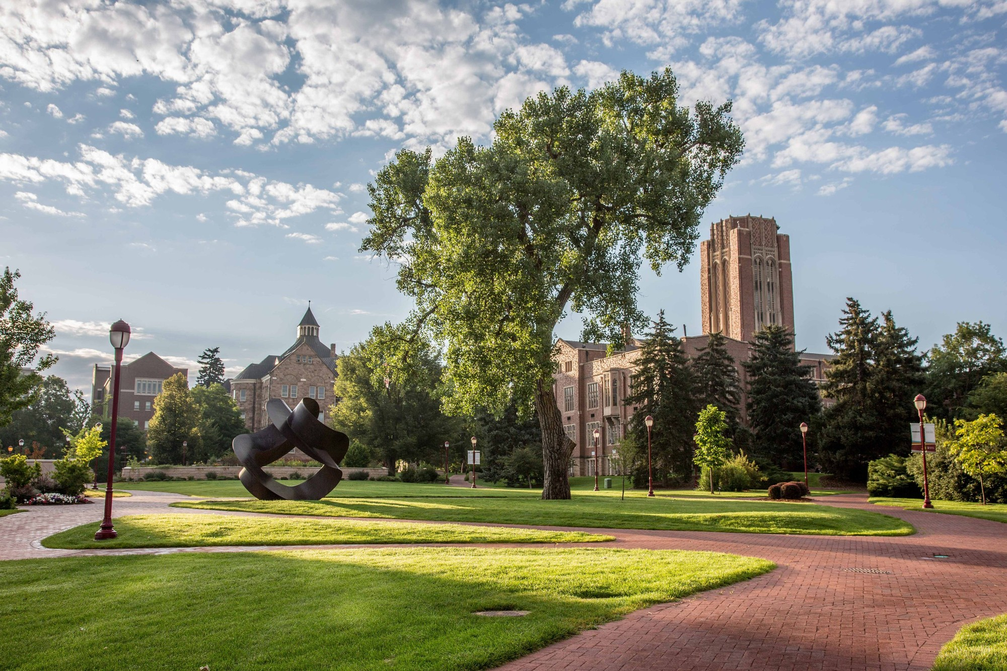 Red brick paths and grassy quads line the campus of University of Denver