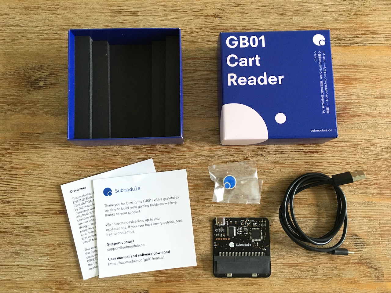 The content of the GB01 Cart Reader box layed out on a table