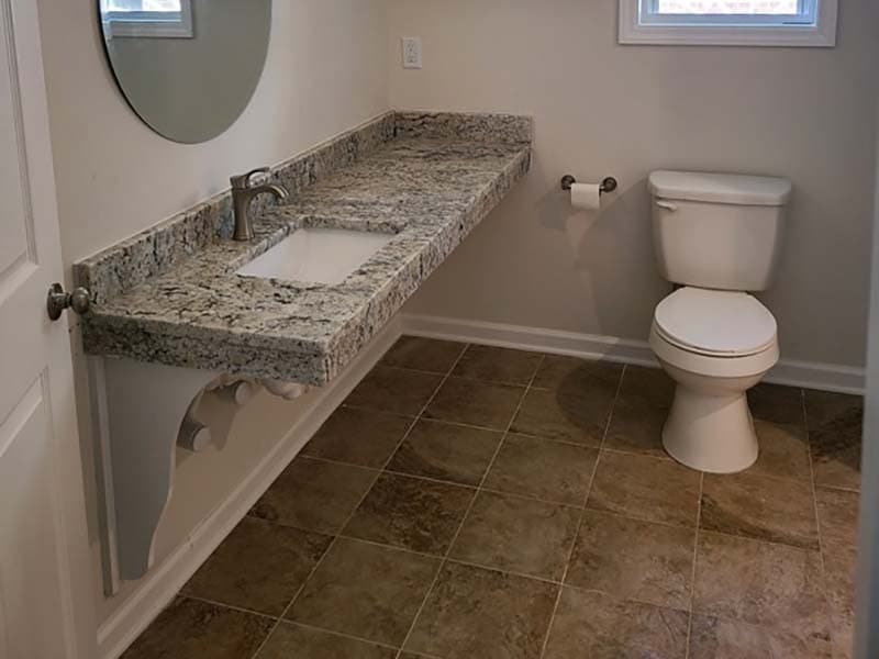 bathroom toilet and sink after a remodel by CorHome