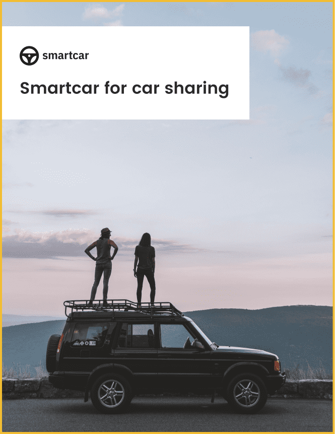 Front-page of Smartcar's car sharing white paper showing two people standing on an SUV in a mountainous sunset landscape