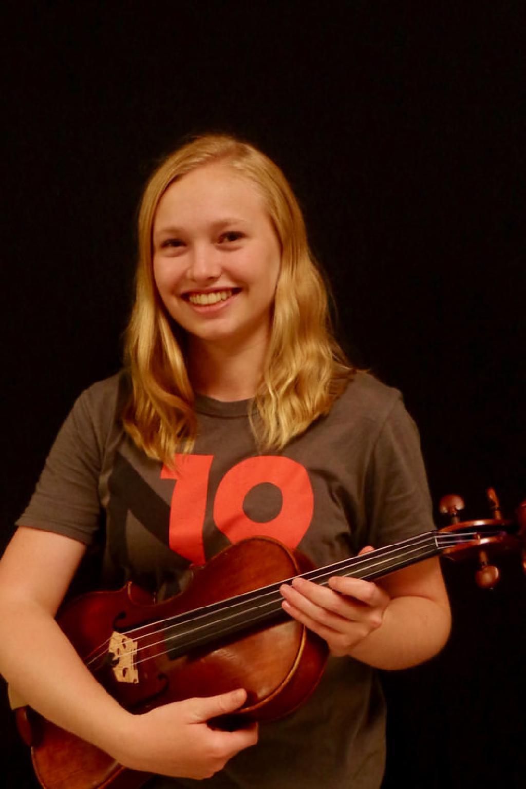 Julia Huckaby with violin.