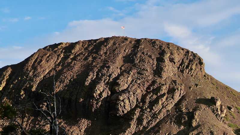 An American flag stands on Ebbetts Peak