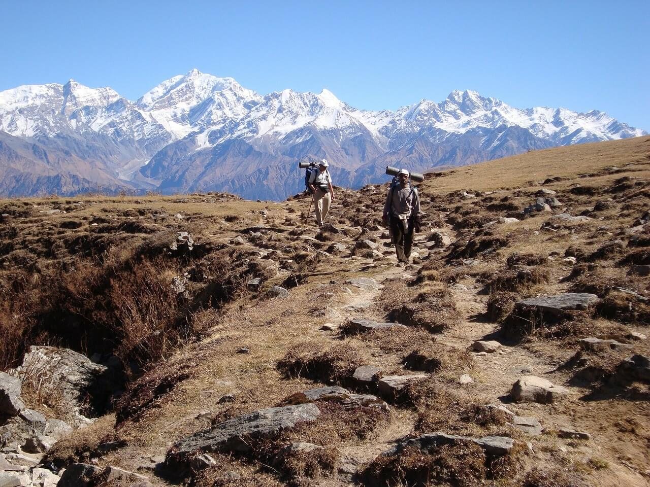 Word famous Sherpa Porter and tourist trekking in the Himalayas