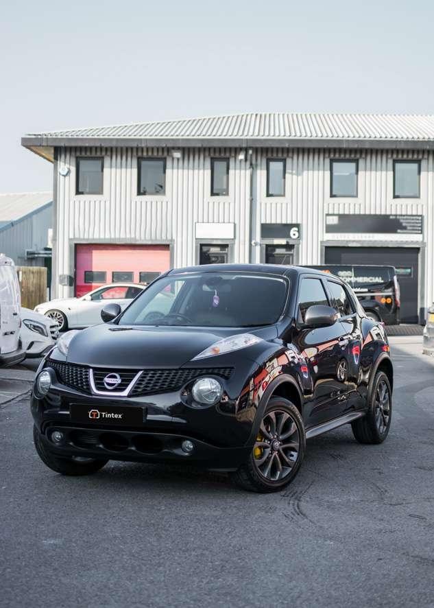 Front shot of polished and ceramic coated black Nissan Juke car