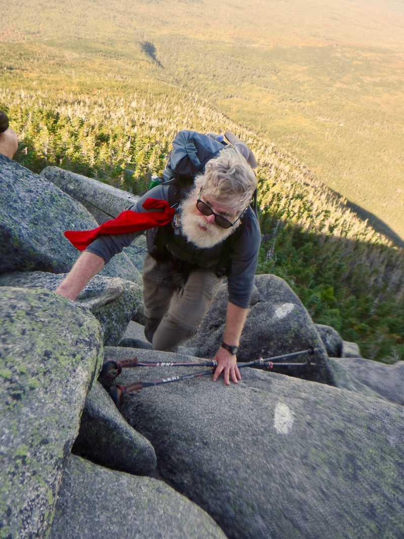 Stick climbs rocks on Mt. Katahdin