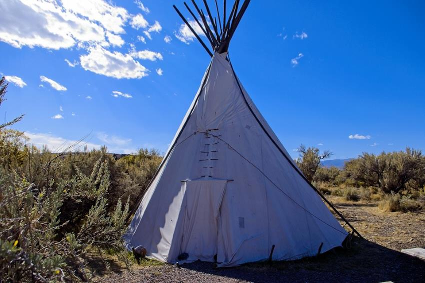 A replica tipi erected in the wilderness, from MikeGoad of Pixabay.
