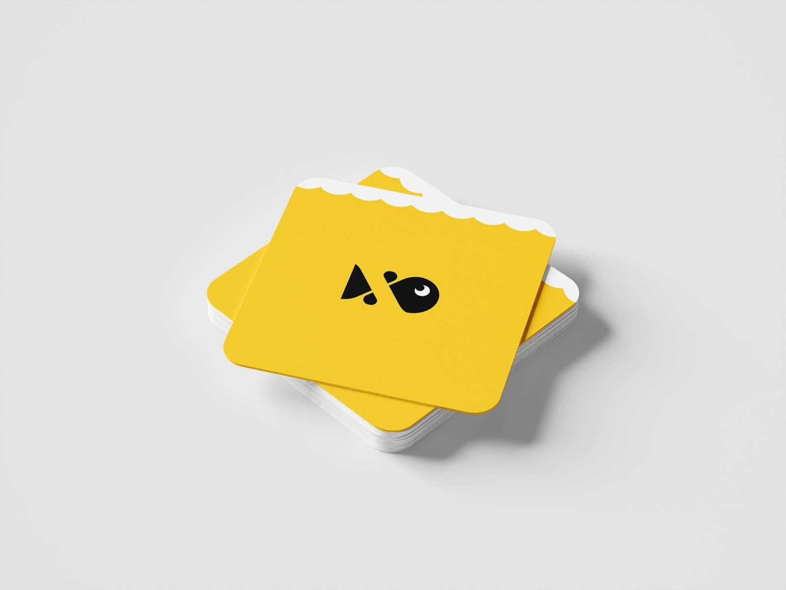 The Fish Snax icon on a set of yellow coasters