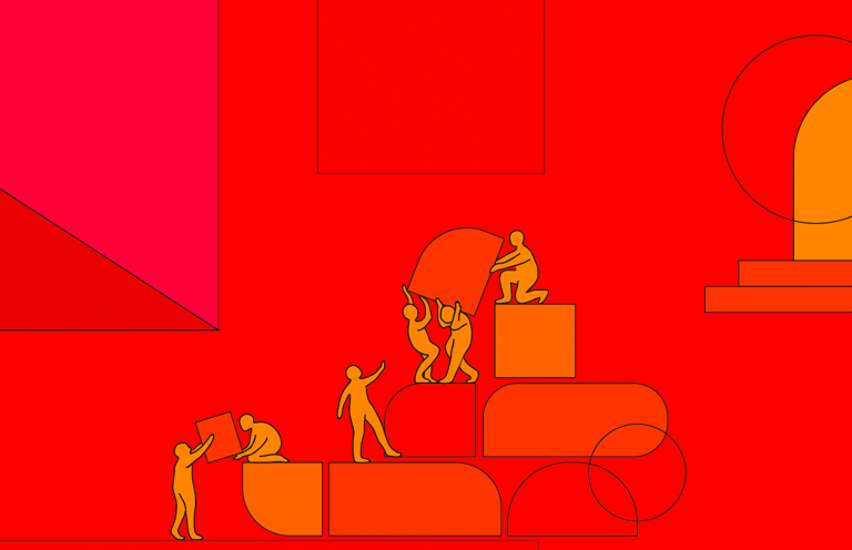 Several people helping each other move blocks up a series of large steps.