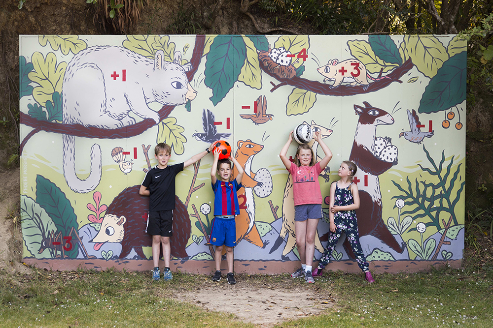 Children in front of a mural