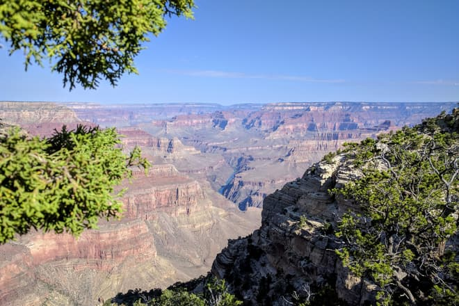 A view into the Grand Canyon from the South Rim. The Colorado River is barely visible in a steep gorge near the center of the Canyon.