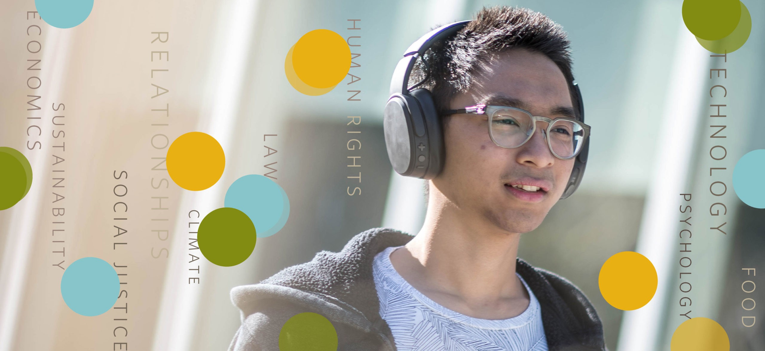 A person listens to UBC talks on his headphones