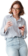Woman in glasses holding a coffee and reading her mobile phone