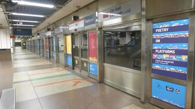 A row of MRT doors with poetry stickers.
