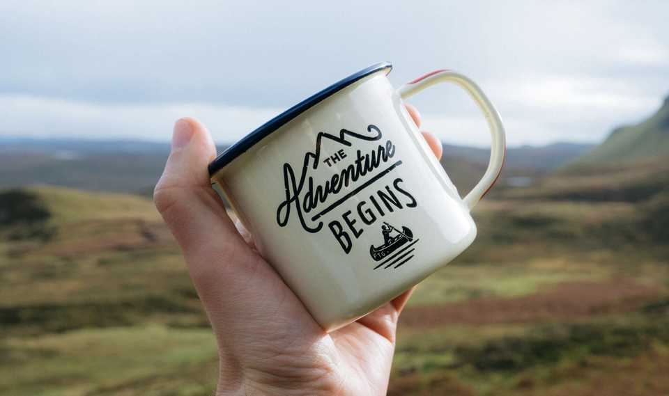 Coffee mug with the caption 'The Adventure Begins'
