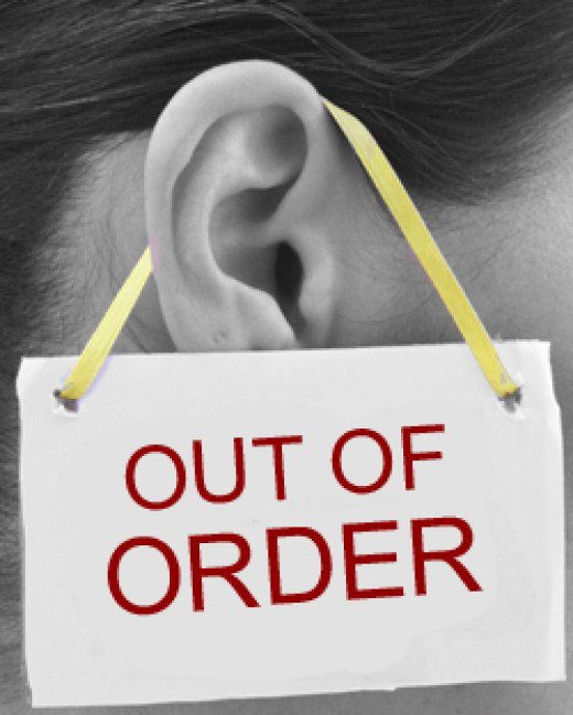 Out of order sign hanging on an ear