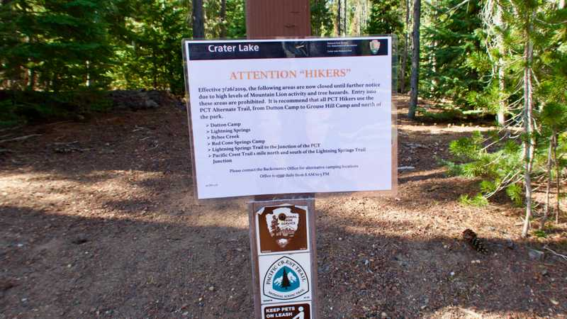 A sign warning of a trail closure in Crater Lake National Park