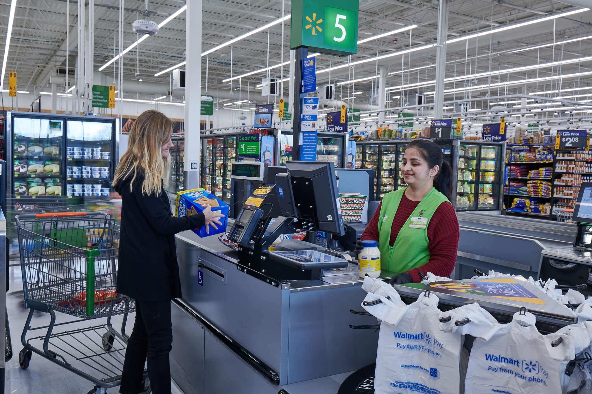 Customer at Walmart IRL checkout counter