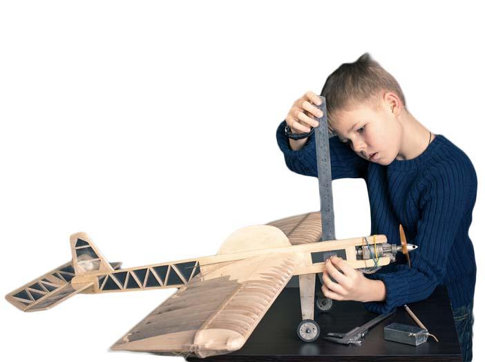 Boy building model airplane