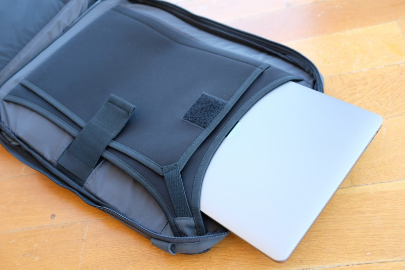The laptop compartment has a very slick design, you slip in your laptop both vertically (from top) or horizontally (from the side).