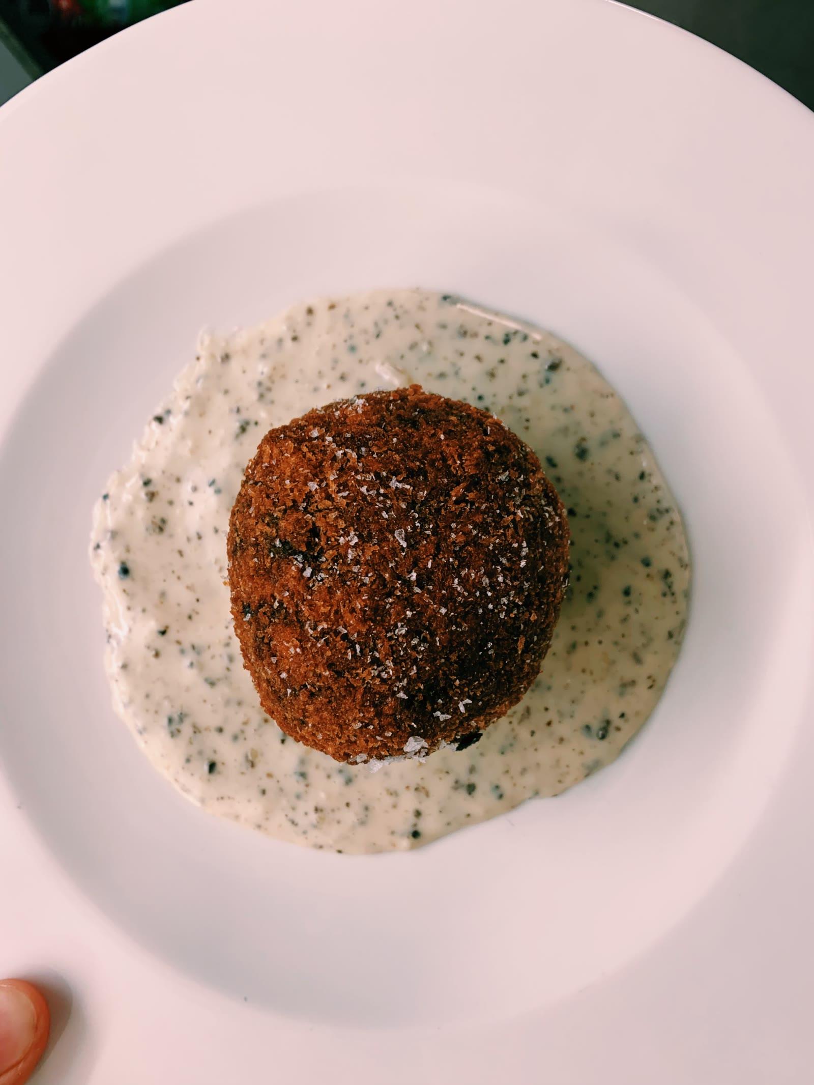 Wild Mushroom Arancini with Truffle Sauce cut open