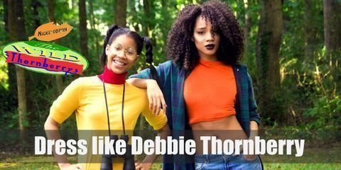 For Debbie Thornberry costume you'll need Green, long-sleeve, plaid shirt. Orange crop top, baggy blue jeans and black Oxford shoes.