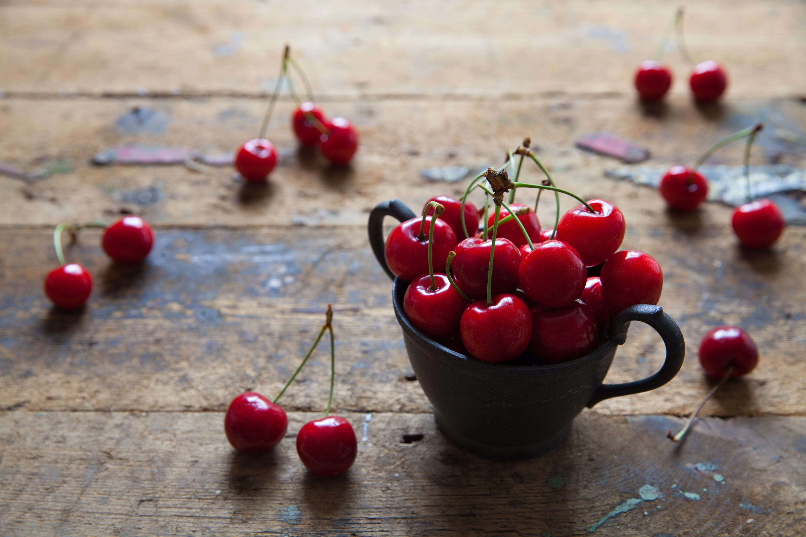 fresh cherries in a pewter pot