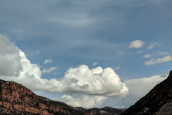 Cold winter clouds above a mountain highway. There is remarkably little snow for this time of year.