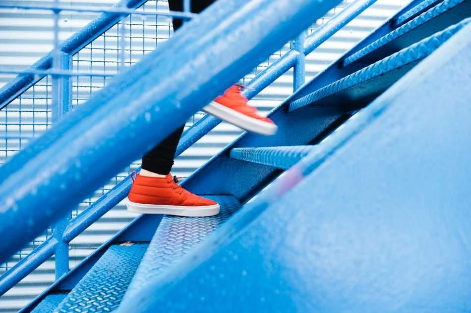Women running up a flight of stairs