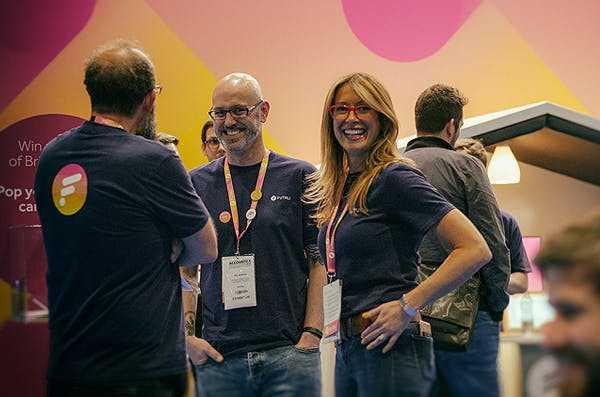 Jon Oakley and Phil Hobden from the Futrli sales team stand next to Futrli Founder & CEO Hannah Dawson at Accountex London.