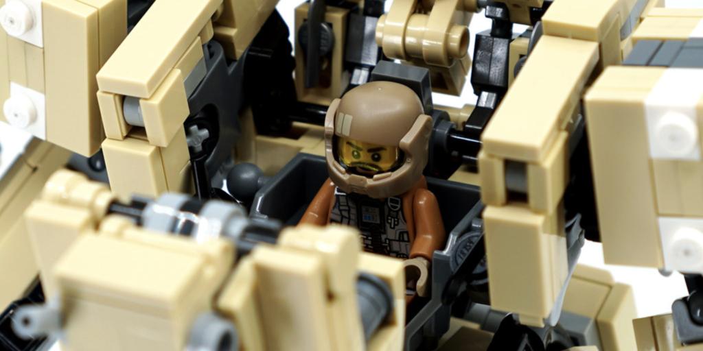 Lego minifig pilot inside of lego mech built by artist Lu Sim.