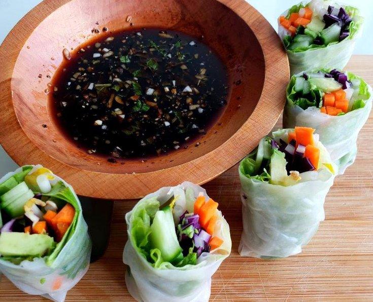 Six summer rolls around bowl of teriyaki dipping sauce