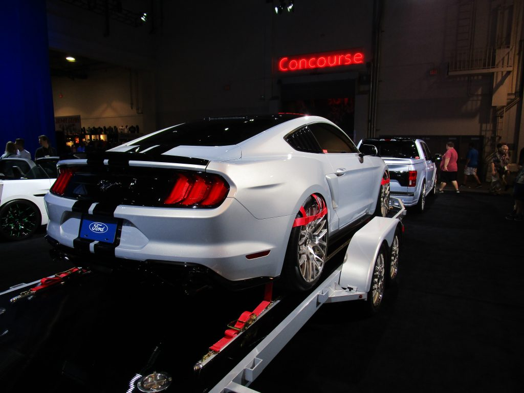 White Ford Mustang on a Flatbed