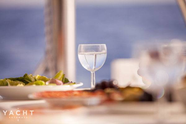 Try the best seafood with boat charter in Greece