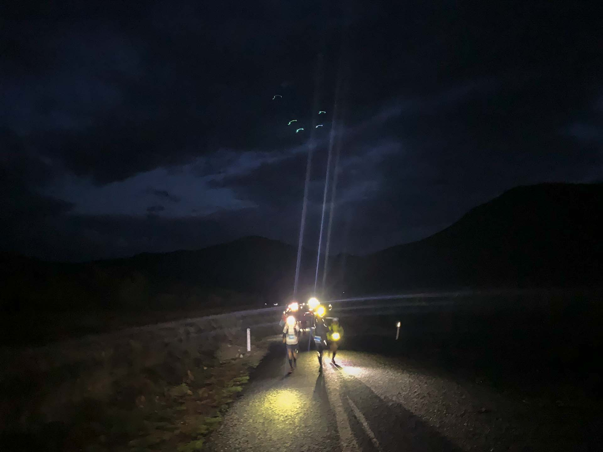 Climbing to Telegraph Saddle, guided by headlamps