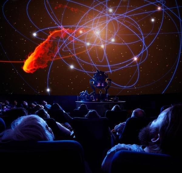 Audience of the planetarium watching a screening