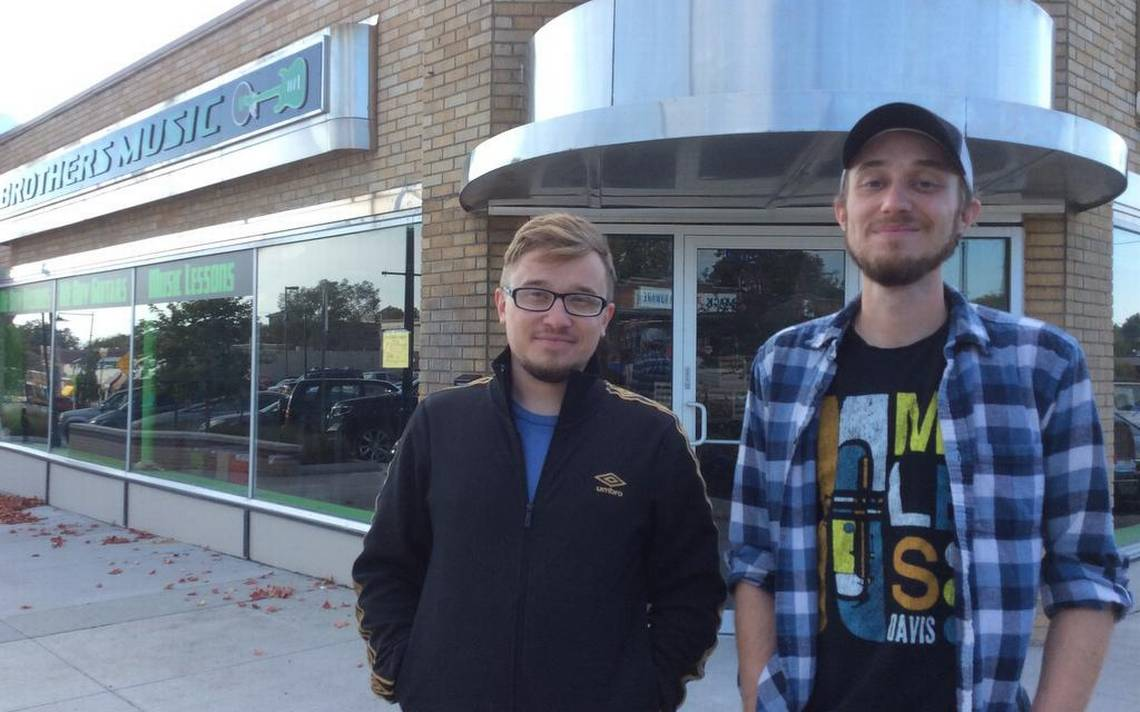 Photograph of the Maggart brothers in front of Brothers Music store in Mission, KS - Photo by KCStar